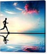 Silhouette Of Man Running At Sunset Canvas Print