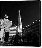 the shard building towering over local buildings including guys hospital in southwark London England Canvas Print