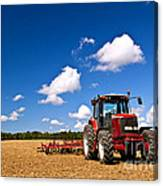 Tractor In Plowed Field Canvas Print