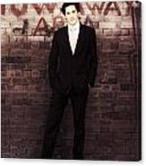 Vintage Salesman Standing In Front Of Brick Wall Canvas Print