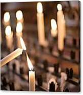 Woman Lighting Prayer Candle Canvas Print