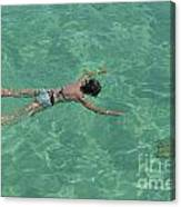 Woman Snorkeling By Turquoise Sea Canvas Print