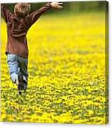 Young Boy Running Through Field Of Canvas Print