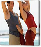 A Man And Woman Practicing Yoga Canvas Print
