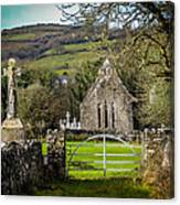 12th Century Cross And Church In Ireland Canvas Print