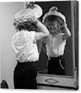 1950s Little Girl Trying On Hat Looking Canvas Print