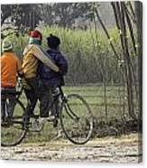 3 Young Children On A Cycle At The Side Of The Road Canvas Print