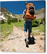 A Backpacker Hiking Canvas Print