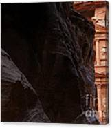 A Glimpse Of Al Khazneh From The Siq In Petra Jordan Canvas Print