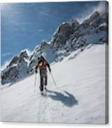 A Man Ski Touring In The Mountains Canvas Print