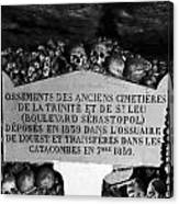 A Marker With Skulls And Bones In The Catacombs Of Paris France Canvas Print