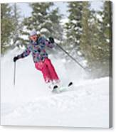 A Skier Descends A Snowy Slope Canvas Print
