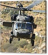 A Uh-60l Yanshuf Helicopter Canvas Print