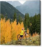 A Young Girl Mountain Biking In The San Canvas Print
