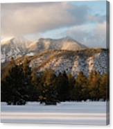 A Young Woman Snowshoes Through Freshly Canvas Print