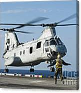 An Aviation Boatswains Mate Directs Canvas Print
