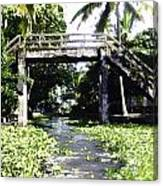An Old Stone Bridge Over A Canal In Alleppey Canvas Print