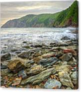 Beautiful Warm Vibrant Sunrise Over Ocean With Cliffs And Rocks Canvas Print