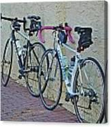 2 Bikes Against Wall Canvas Print