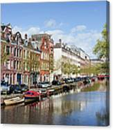 Boats On Amsterdam Canal Canvas Print