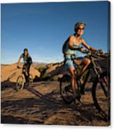 Couple Mountain Biking, Moab, Utah Canvas Print