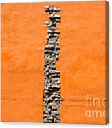 Crack Of Bricks In Orange Wall Canvas Print