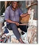 Kenya. December 10th. A Man Carving Figures In Wood. Canvas Print