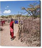 Maasai People And Their Village In Tanzania Canvas Print