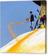 Man Throwing Orange Paint On Boudhanath Stupa Canvas Print
