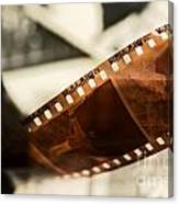 Old Film Strip And Photos Background Canvas Print