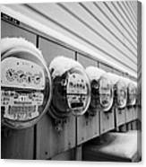 snow covered electricity meters in Saskatoon Saskatchewan Canada Canvas Print