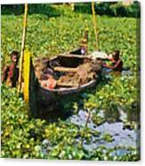 Taking Mud From The Bottom Of The Canal Canvas Print