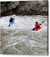 Two Kayakers Carry Their Boats Canvas Print