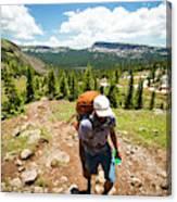 A Backpacker Hiking Canvas Print