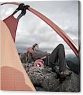 A Man Setting Up A Tent Canvas Print