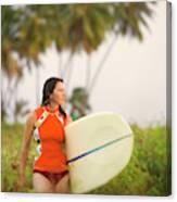 A Woman Carries A Surfboard To The Beach Canvas Print