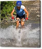 A Woman Mountain Bikes Along Trail 401 Canvas Print