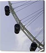 3 Capsules Of The Singapore Flyer Along With The Spokes And Base Canvas Print