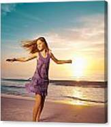 Girl Jumping And Dancing On Beautiful Beach. Canvas Print
