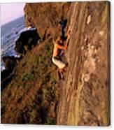 A Man Is Bouldering Near The Ocean Canvas Print