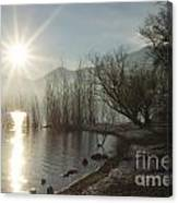 Sunshine Over An Alpine Lake Canvas Print