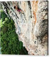 A Athletic Man Rock Climbing High Canvas Print