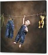 A Baby On The Clothesline Canvas Print
