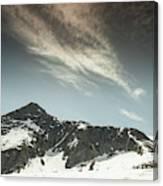 A Backpacker Gazes Up At Needle Peak Canvas Print