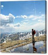 A Backpacker Stands Atop A Mountain Canvas Print