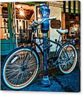 A Bike In Front Of Cafe Du Monde In New Orleans Canvas Print