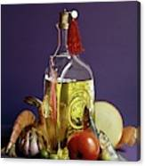 A Bottle Of Olive Oil Surrounded By A Variety Canvas Print
