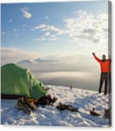 A Camper Lifts His Hand In The Air Canvas Print