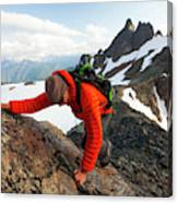 A Climber Scrambles Up A Rocky Mountain Canvas Print