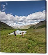 A Couple Hiking Through A Field Canvas Print